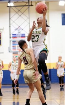 #23 Carla Howard of Holy Cross puts up a shot over #0 Aamya Rivera of Sacred Heart during the girls NVL Tournament semi-final in Waterbury Monday. Steven Valenti Republican-American