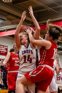 Northwestern's Morgan Plitt (12), right, collides with Nonnewaug's Madeline Roden (14) while battling for a rebound during the Girls Basketball Berkshire League finals between Nonnewaug and Northwestern at Northwest Regional High School in Winsted on Friday. Bill Shettle Republican-American