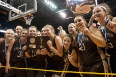 The Thomaston girls basketball team celebrate their 2-50 win over Canton to capture the Class S state championship Saturday at the Mohegan Sun Arena. Jim Shannon Republican-American
