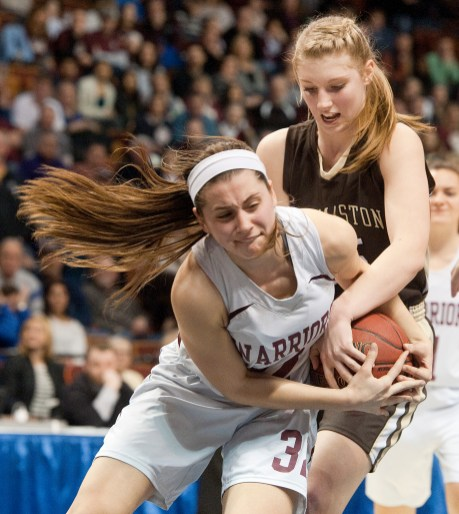 Thomaston's Casey Carangelo (35) battles for a loose ball with Canton's Gabrielle Rose (32) during the Class S state championship Saturday at the Mohegan Sun Arena. Jim Shannon Republican-American