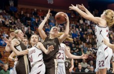 Thomaston's Morgan Sanson (14) pulls down a rebound between Canton's Abbe Skinner (21) and Emily Briggs (22) during the Class S state championship Saturday at the Mohegan Sun Arena. Jim Shannon Republican-American