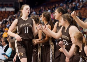 Thomaston's Abby Hurlbert (11) is congratulated by teammates as she makes her way to the bench during their Class S state championship game with Canton Saturday at the Mohegan Sun Arena. Jim Shannon Republican-American