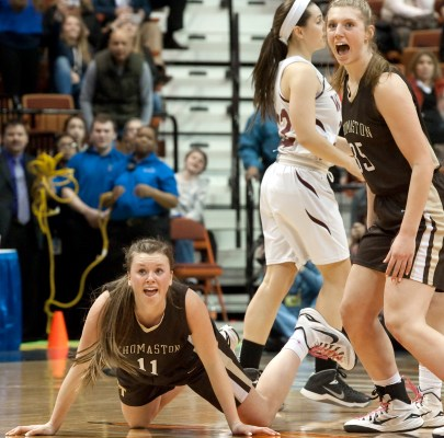 Thomaston Abby Hurlbert (11) and Casey Carangelo (35) look to the clock as time expires in their 52050 win over Canton to capture the Class S state championship Saturday at the Mohegan Sun Arena. Jim Shannon Republican-American