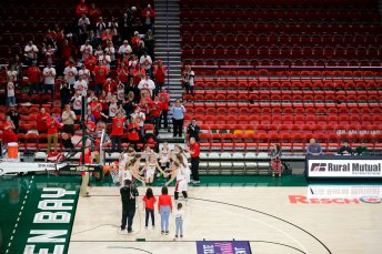 The stands are mostly empty as a small crowd cheers as Arcadia High School is announced before a Div. III semifinal game against Platteville High School at the WIAA girls state basketball tournament Thursday, March 12, 2020, at the Resch Center in Ashwaubenon, Wis. Wisconsin Gov. Tony Evers declared a public health emergency, the state Capitol closed to formal tours and the state high school athletics association moved to drastically limit attendance at remaining winter tournaments Thursday as officials scrambled to prevent the further spread of the new coronavirus in Wisconsin. (Dan Powers/The Post-Crescent via AP)