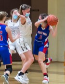 Nonnewaug's Samantha Conti (4) looks to get a pass around Thomaston's Emma Kahn (1) during their Berkshire League championship game Friday at Thomaston High School. Jim Shannon Republican American
