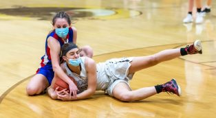 Nonnewaug's Samantha Conti (4) and Thomaston's Ava Harkness (21) hit the floor for a loose ball during their Berkshire League championship game Friday at Thomaston High School. Jim Shannon Republican American