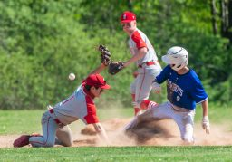 Litchfield's Jason Thompson (9) safely steals second base after the ball skips past Northwestern's Jacob Lavoie (1) during their game Wednesday at Litchfield High School. Jim Shannon Republican American