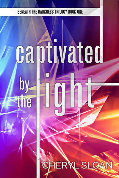 CAPTIVATED BY THE LIGHT , the first book in the adult romantic suspense trilogy, Beneath the Darkness, by Cheryl Sloan