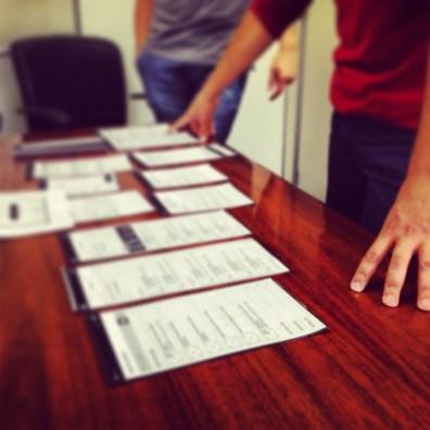 Teste de Usabilidade. Com esse protótipo em papel, validamos algumas questões do redesign da aplicação.