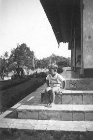 My father, Willem, on the steps of his home before the war.