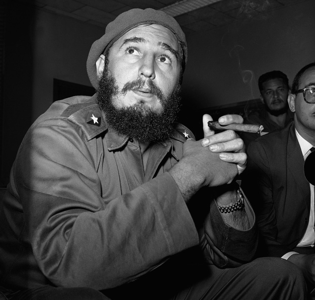 FILE - In this June 14, 1961 file photo, Prime Minister Fidel Castro holds a cigar during a news conference in Havana, Cuba. For over half a century, the U.S. government tried many schemes to overthrow the Castro regime: poisonous cigars, an exploding seashell, the secret Twitter-like service in Cuba. U.S. President Barack Obama said Wednesday, Dec. 17, 2014 the United States will re-establish diplomatic ties with Cuba and bring change to the longstanding trade embargo. But it was unclear if all secret operations would cease. (AP Photo/RHS)
