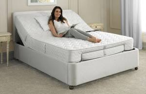 Woman lying on adjustable bed
