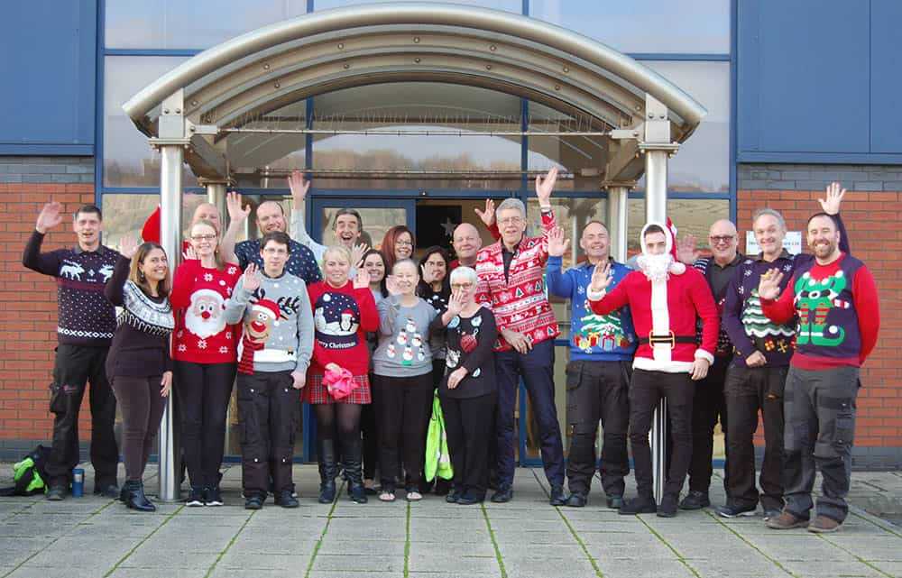 The team at Harvest Healthcare wearing Christmas Jumpers for Save the Children