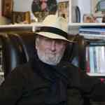 David Garman Sitting in chair with a hat