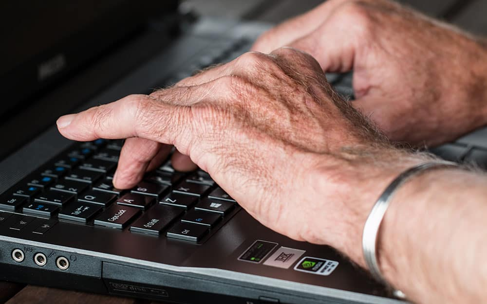 Old person typing image