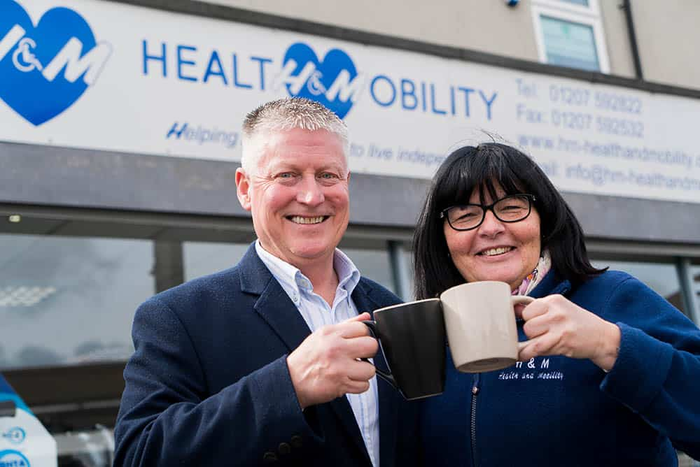 H&M Health & Mobility's Hugh and Yvonne Malone outside shop front