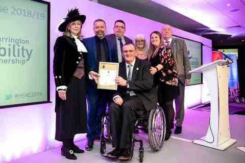 Warrington Disability Partnership team and Dave Thompson at award April 2019