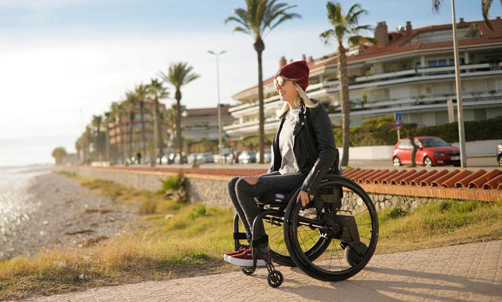 Invacare SMOOV one woman riding in wheelchair