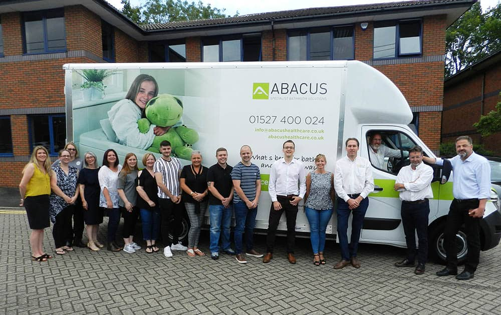 Members from the Gainsborough Healthcare Group celebrate the arrival of the new Abacus Specialist Bathroom Solutions Demonstration Vehicle.