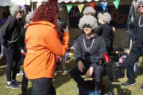 Clearwell Mobility MD Duncan Gillett on scooter dressed as granny