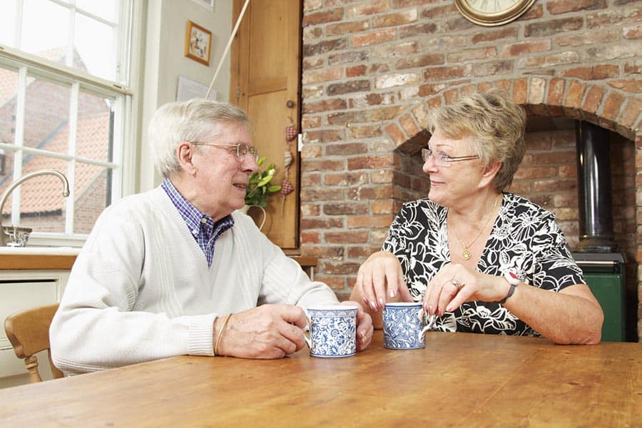Tunstall - Carers - couple having coffee