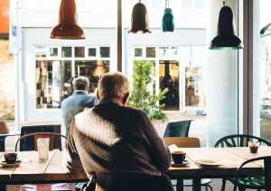 elderly gentleman sitting in a cafe