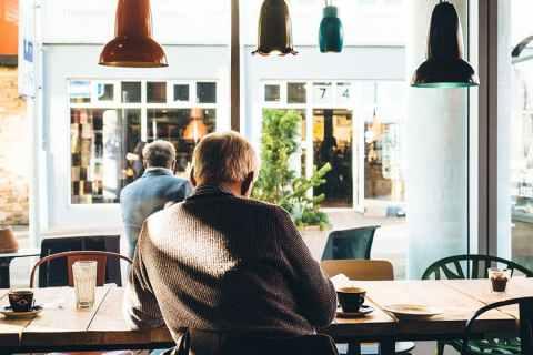 elderly gentleman sitting in a cafe