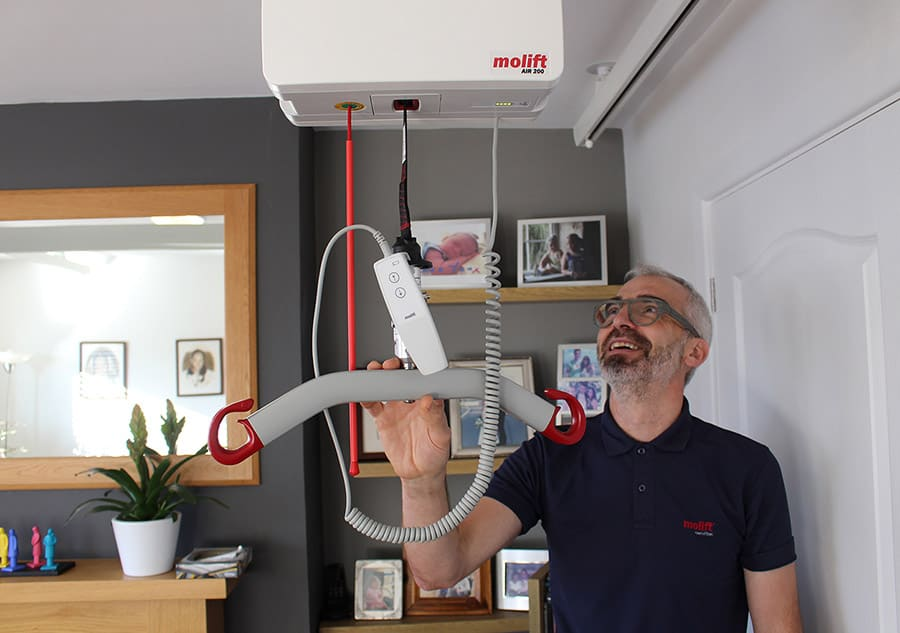 Colin Williams with Molift hoist image