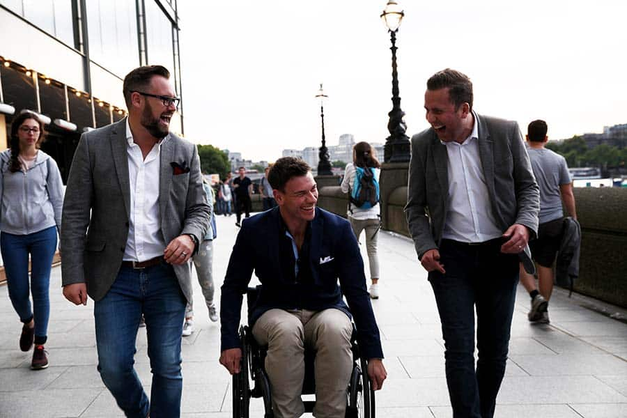 360 Wheelchairs Ryan Hirst walking with colleagues