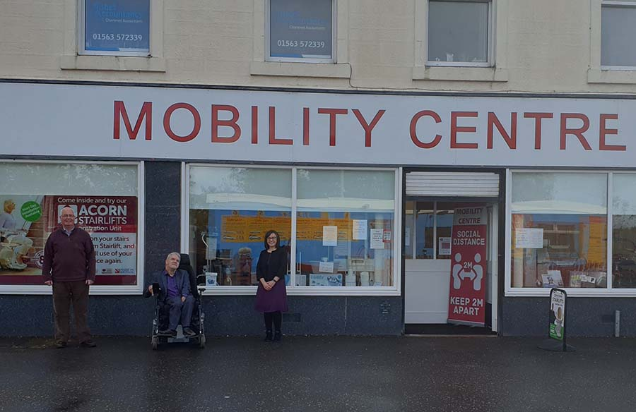 Thistle Help and Mobility Centre founders outside Mobility Centre branch