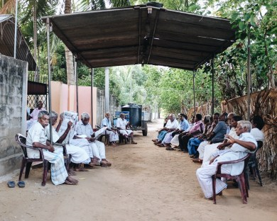 """during the morning poosai, people from the village, mostly elder men, will attend the funeral. After the poosai everyone will join the mourning family to the hot springs of keerimalai, where the ashes will be thrown into the sea and everyone takes a bath in the """"sacred"""" water spring."""