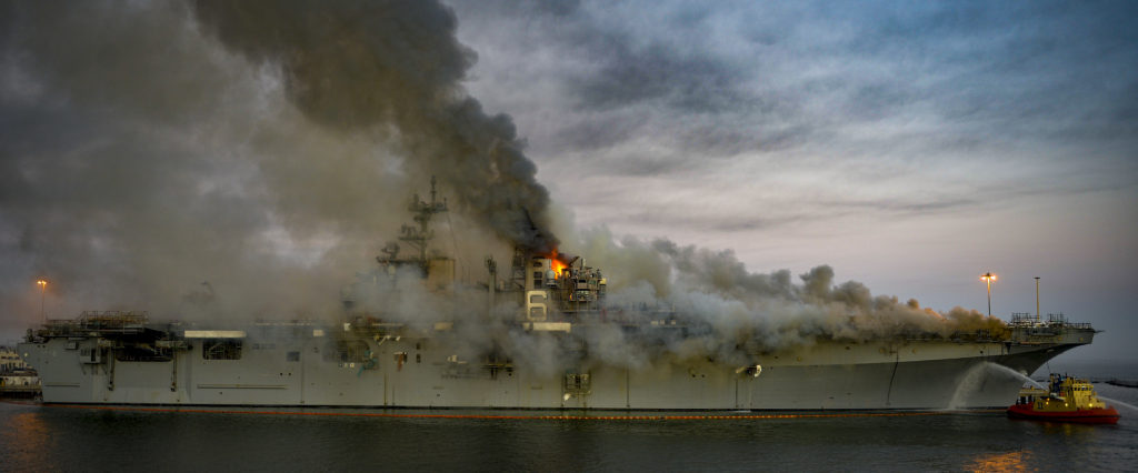SAN DIEGO (July 12, 2020) A fire continues to be fought into the evening on board the amphibious assault ship USS Bonhomme Richard (LHD 6) at Naval Base San Diego, July 12. On the morning of July 12, a fire was called away aboard the ship while it was moored pier side at Naval Base San Diego. Base and shipboard firefighters responded to the fire. Bonhomme Richard is going through a maintenance availability, which began in 2018.