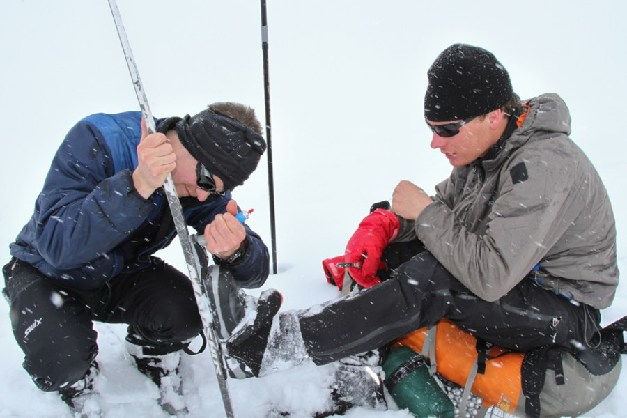 Brad Marden trying to free Eben Sargent from his skis.