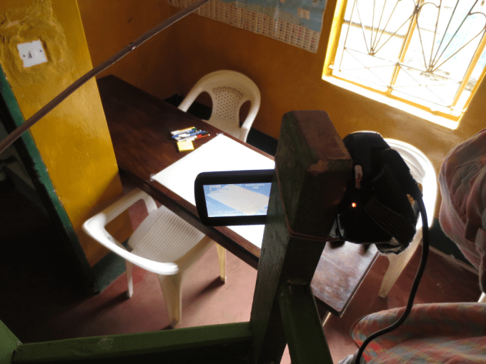 Improved but still makeshift recording setup - video camera is angled so as to only record the map, not the participant due to research ethical considerations (© Michael Waltinger)