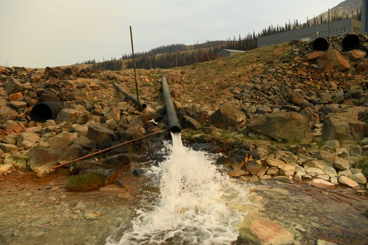 A pipe flows from a state water treatment plant at the Superfund site at Summitville Mine in Summitville, Colorado.