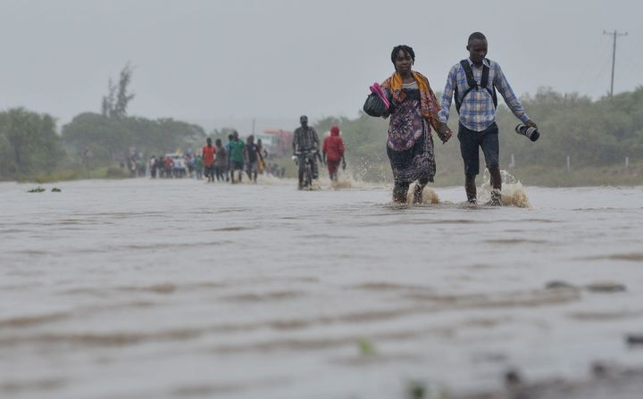 Residents brave the floods in Mazive, southern Mozambique, on April 28, 2019, after a cyclone brought heavy rains.