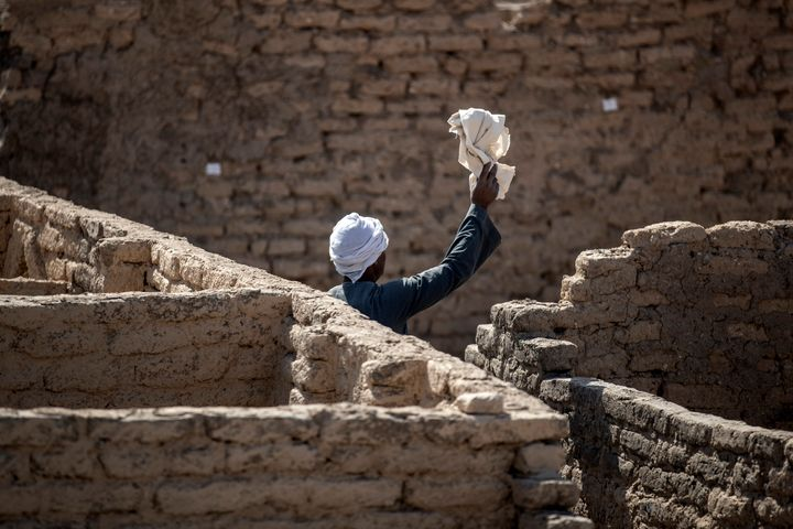 A worker at the site of the 3,400-year-old lost city of Aten on April 10 in Luxor, Egypt.
