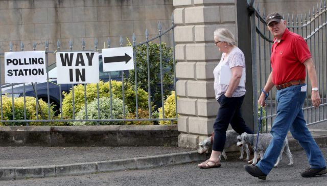 People leave a polling station