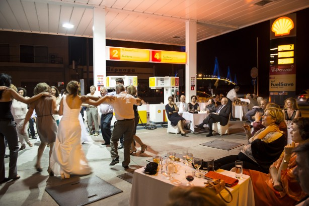Greeks are dancing the traditional sirtaki dance at the wedding party of Anna and Christos Karalis. Christos, who owns a gas station in the port city of Patras, decided to organise the party at his work place, to save on party expenses. From the series 'Mediterranean. The Continuity of Man' (2010-2014). ©Nick Hannes