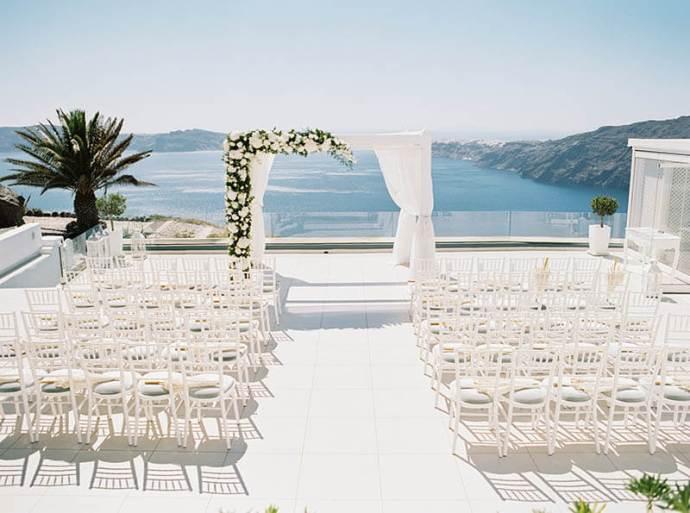 Romantic Blush & Copper Wedding - breathtaking wedding setting in Santorini Wedding