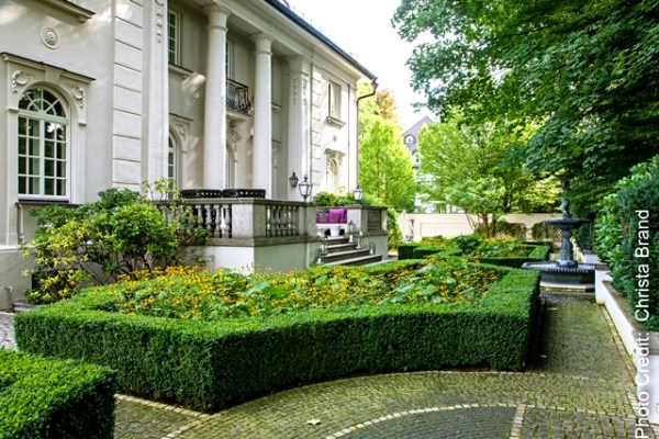 Community-based plantings contained by formal box parterres Copyright Christa Brand