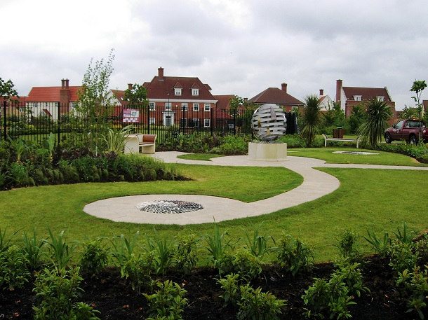 Boleyn Park, Chelmsford. Wide paths to seat either side of sculpture, with space either side of seat, designed by Bella