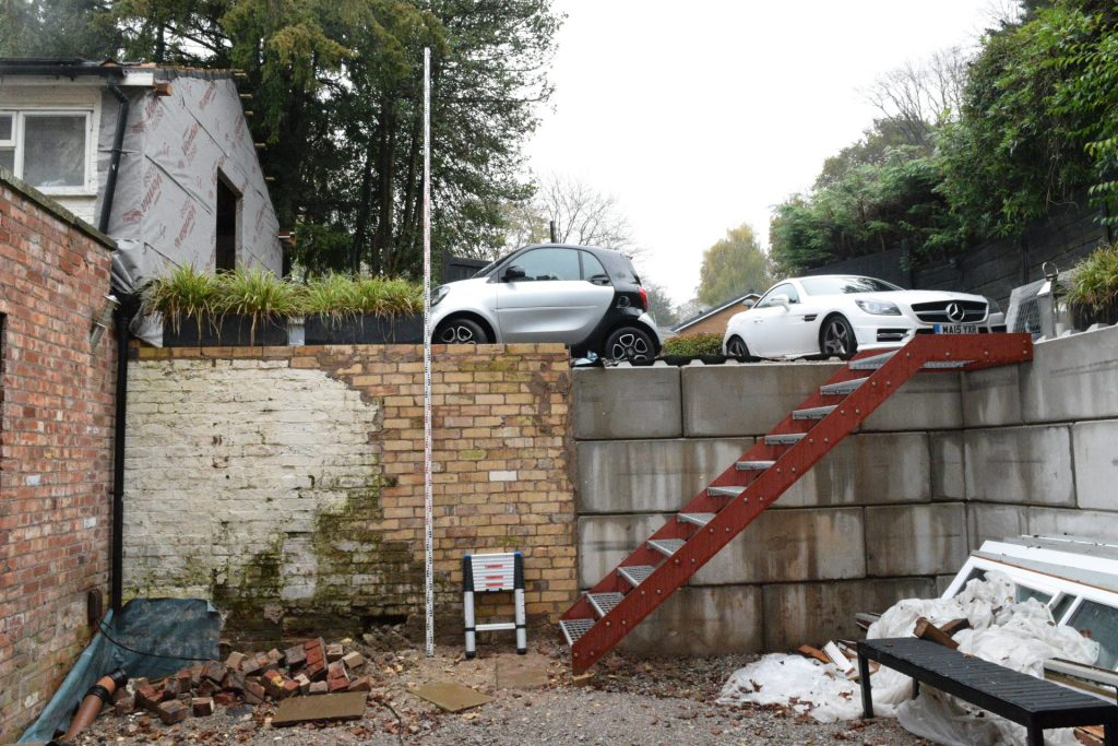 Building site with brickwork retaining wall and steel stairway