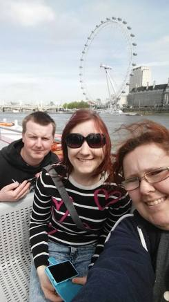 My friends and I in front of the London Eye.