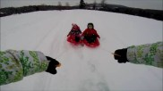 getting towed on the sleds