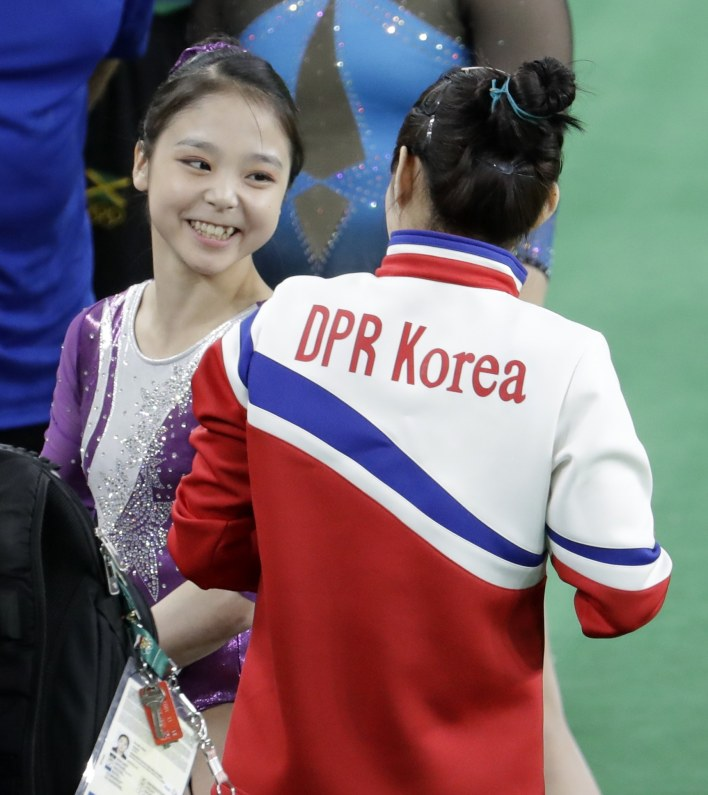 South Korea's Lee Eun-ju, left, talks with North Korea's Hong Un Jong.