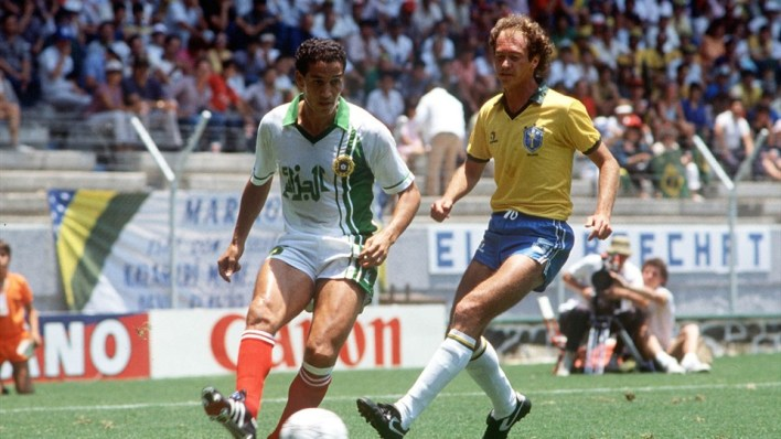 Algeria's Fawzi Mansouri is pursued by Brazil's Falcao at Mexico 1986- Image courtesy: FIFA Official Website