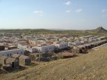 The Sardar Nagar relocation site for impoverished earthquake-affected families of Bhuj. The master plan includes 1200 homes, three schools, and productive farms. Photo by Hunnarshala.