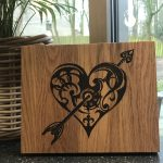 Tribal heart, wood burnt on oak.