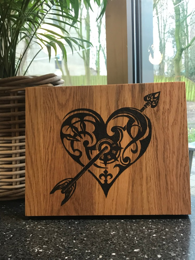 Tribal heart, wood burnt on oak.